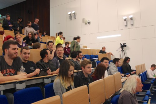 Attendees taking their seats in the Main Lecture Theatre at Abertay University