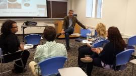 Chris Bacon, Ph.D., speaks to Ohio Fair Trade Expo attendees at John Carroll University