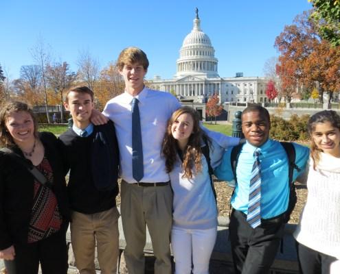 Regis Jesuit High School students and staff