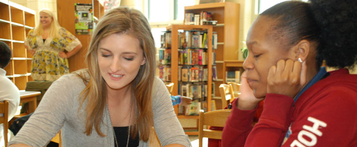 JCU student engaged in service learning