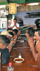 Men praying at the comedor at the Kino Border Initiative [Original Image Source: Jesuit Province of California]