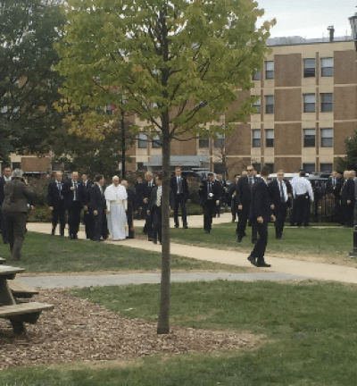 Pope Francis walks across Saint Joseph's University campus during his brief visit, the first for him to a U.S. Jesuit university campus.