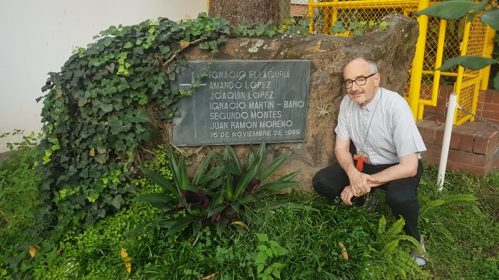 Michael Cardinal Czerny, SJ at the boulder and plaque, and the rose garden, mark where the 6 Jesuit brothers were murdered, while the mother and daughter were murdered in a bedroom a few paces away ... the roses planted by the husband-father who was watchman at the gate that night .