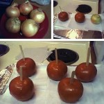 Onions made to look like candy apples.