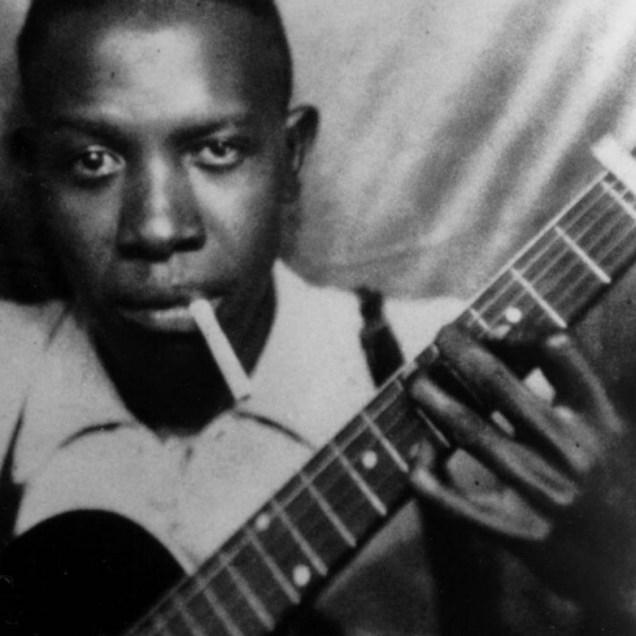 Robert Johnson jovem e seu violão
