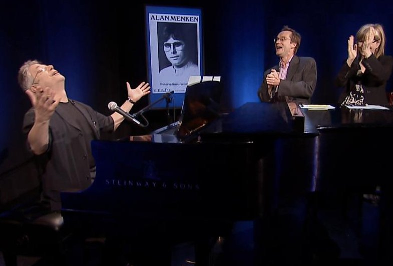 Alan Menken at the piano with hosts Susan Haskins and Michael Riedel