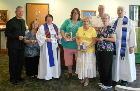 The Rev. Fran Begonja (third from left) receives new members into The Order Of St Luke