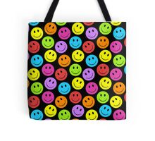 Happy Colorful Smiley Faces Pattern Tote Bag. Happy, happy! Smile, smile! Joy, joy! If you are crazy for smiley faces you will love this colorful smiley face pattern in yellow, green, blue, purple, red, orange, on a black background.