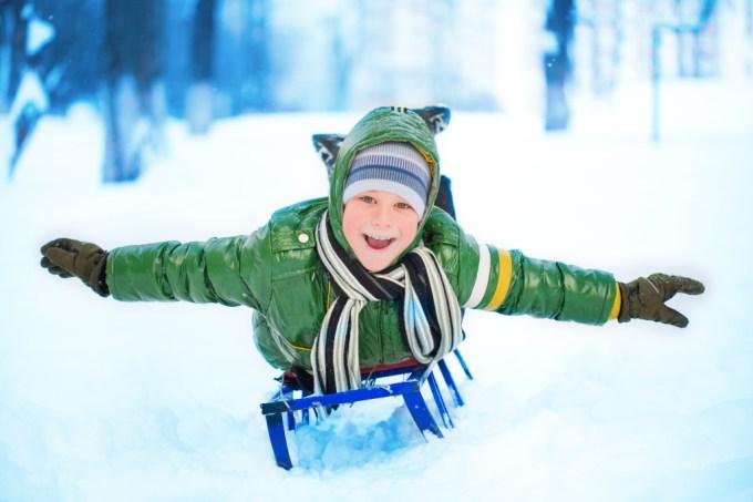 Little boy on sleigh