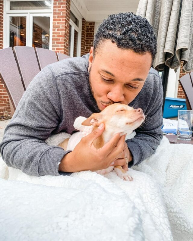 Man kissing Chihuahua