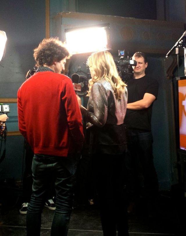 Jeremy Fisher being interviewed by Danielle Graham of etalk