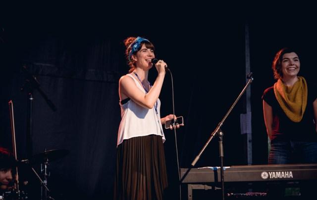 Kristin introducing Coszmos Quartette. Photo by Lisa Vuyk