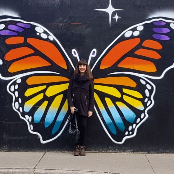Kristin posing with street art in Ottawa