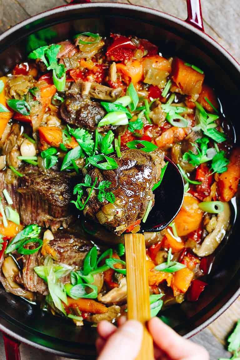 beef stew in a dark bowl