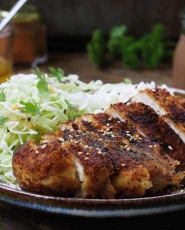 Paleo Chicken Katsu with thin shredded cabbage noodles in light Asian sesame ginger dressing. Paleo Whole30 chicken cutlets. Paleo Asain food. IHeartUmami.com