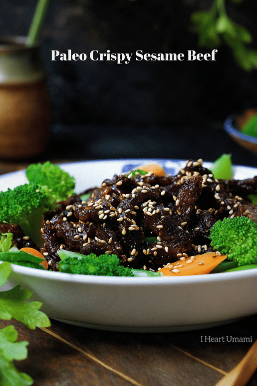 Paleo crispy sesame beef ! Thin sliced sirloin steak pan fried to golden crispy paired with light refreshing veggies. Healthy and super-delicious sesame beef that won't weigh you down. Paleo Chinese takeout. IHeartUmami.com