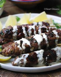 Delicious Paleo lamb kebab skewers recipe with fresh herbs in dairy free Tzatziki inspired tahini dressing.