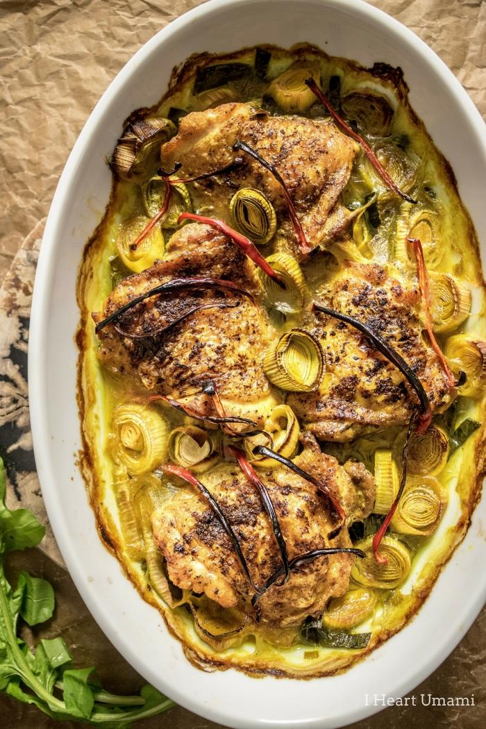 A super simple and truly delicious Oven Baked Crispy Tender Turmeric Chicken Thighs recipe with crispy skins and tender juicy thigh meat baked in turmeric coconut milk cream until sweet and melt-in-your mouth creamy juicy. This simple flavorful and little hands-on time dish will become your everyday go-to chicken thigh casserole recipe ! #bakedchickenthighs #chickenthighs #ovenbaked #chicken #chickencasserole #iheartumami