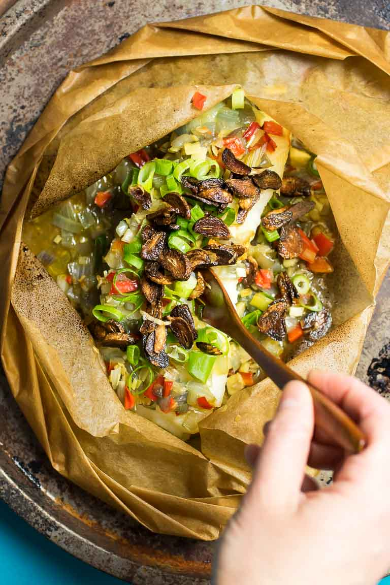 Paleo Fish en Papillote recipe, wrapped in parchment paper with Thai lemongrass and crispy garlic cloves.