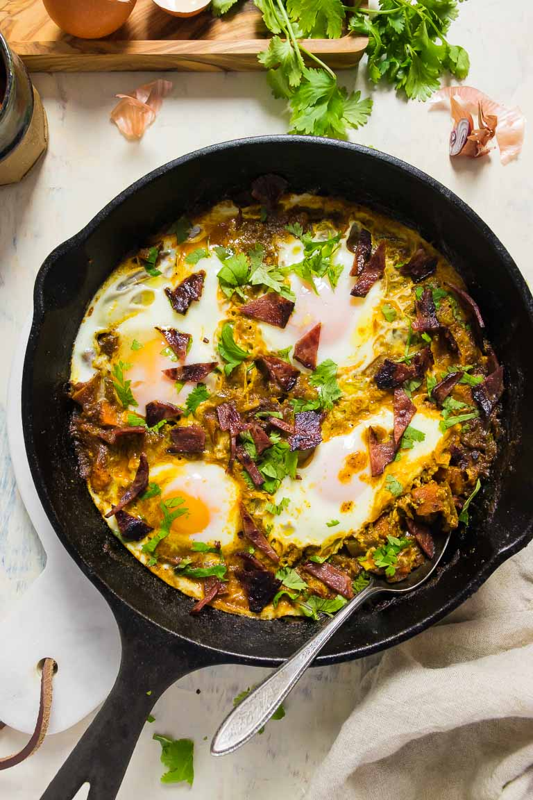 Healthy Shakshuka Recipe with meat and eggs in tomato sauce.