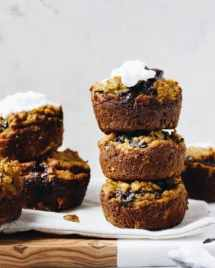 Paleo Pumpkin Protein Muffins Recipe with dark chocolate and coconut yogurt frosting.