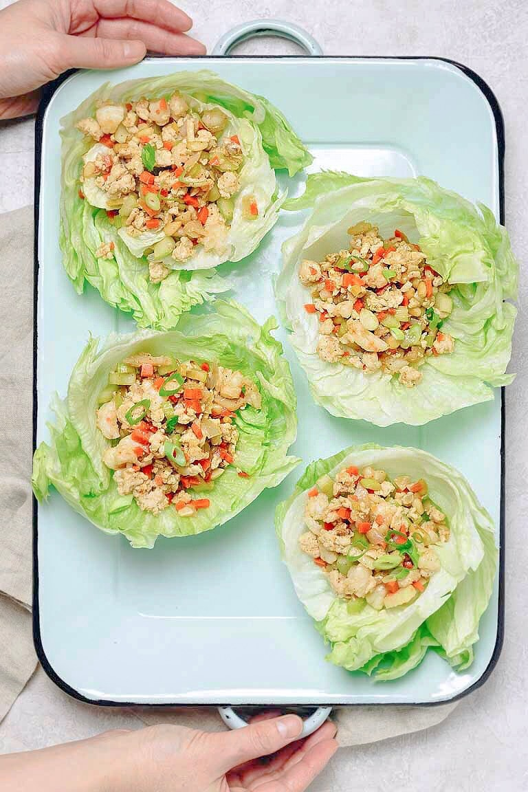 Healthy Paleo Chinese Chicken Lettuce Wraps recipe with chicken or shrimp, loaded with crunchy vegetables in a sweet savory brown sauce.