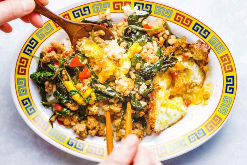 Pad Krapow Gai Spicy mixed with eggs and rice