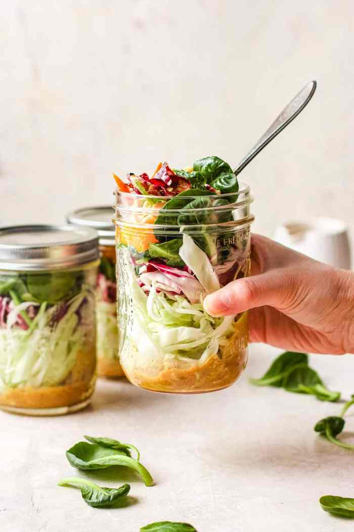 Image shows packing the salad in a big mason jar for portable meal