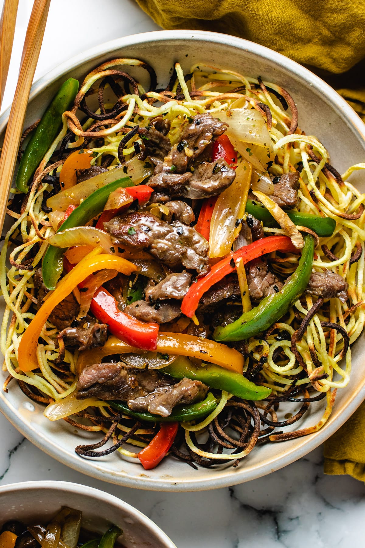Beef chow mein served in individual serving plate