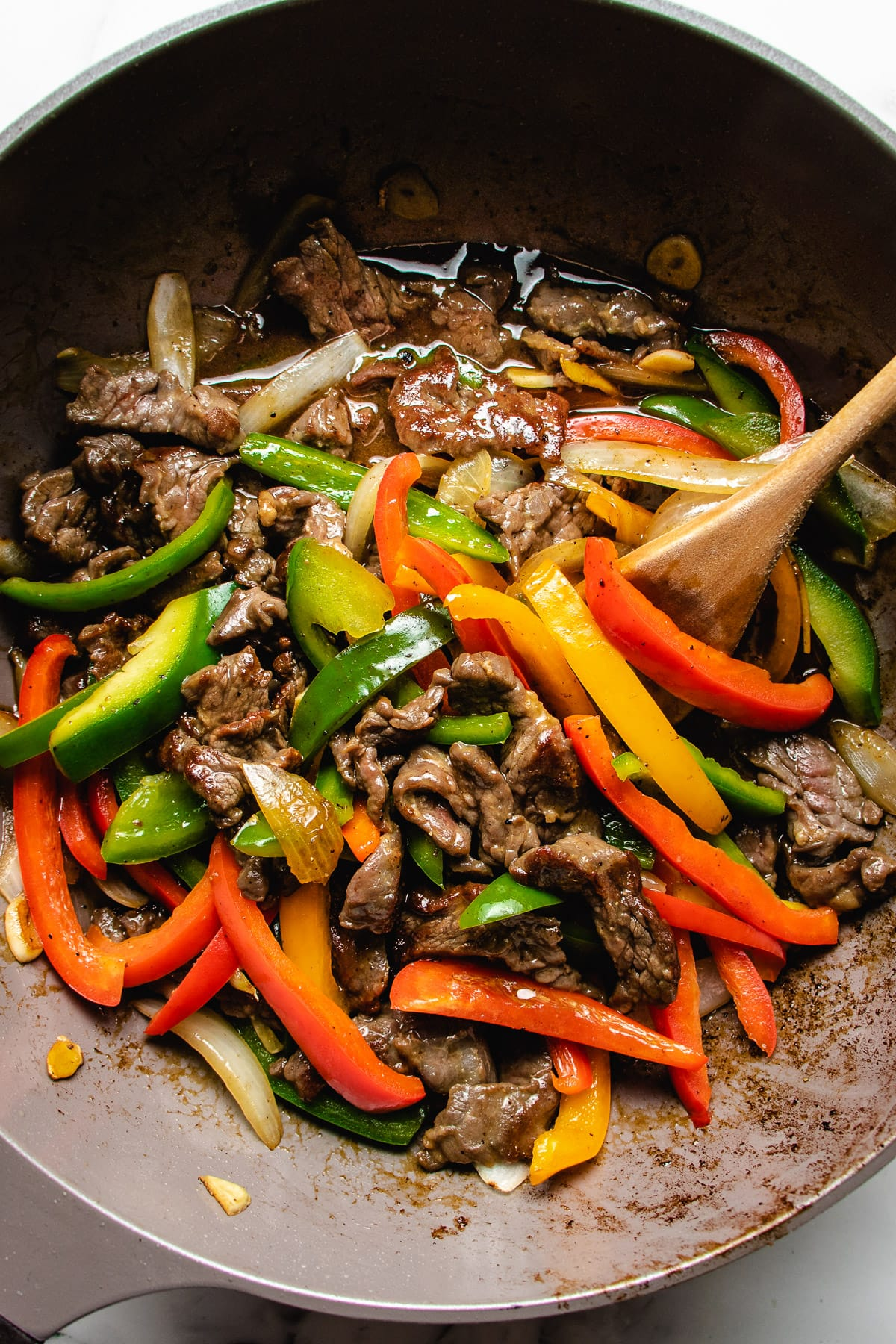 Beef and pepper stir-fry in a wok with extra chow mein sauce