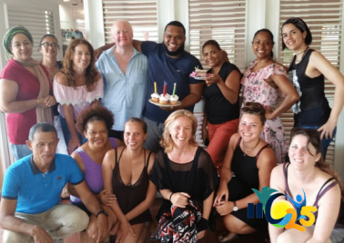 Student facilitator Jeffry Meson celebrates its birthday with his colleagues and students learning Spanish at IIC Spanish School in Sosua, Dominican Republic.