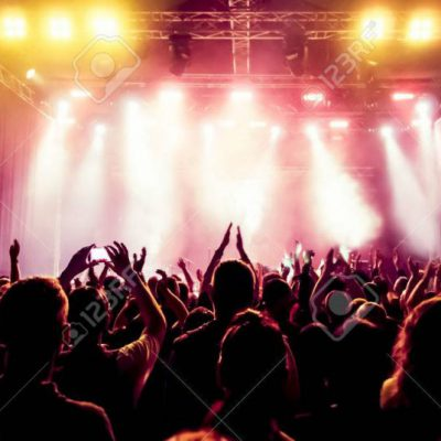 29458457-silhouettes-of-concert-crowd-in-front-of-bright-stage-lights