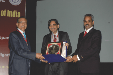 Receiving award for his 17 years of service to POSI  - At POSICON 2011 in Chandigarh