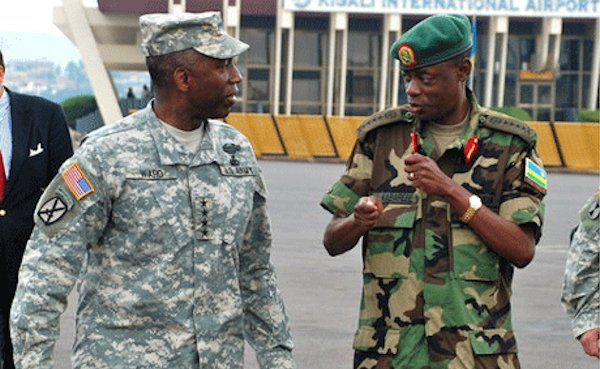 Minister Gen. James Kabarebe (R)---indicted by Spain for war crimes, crimes against humanity and genocide in Central Africa---speaks to US AFRICOM chief General William Ward in Rwanda, July 2010. (Photo credit AFRICOM.)