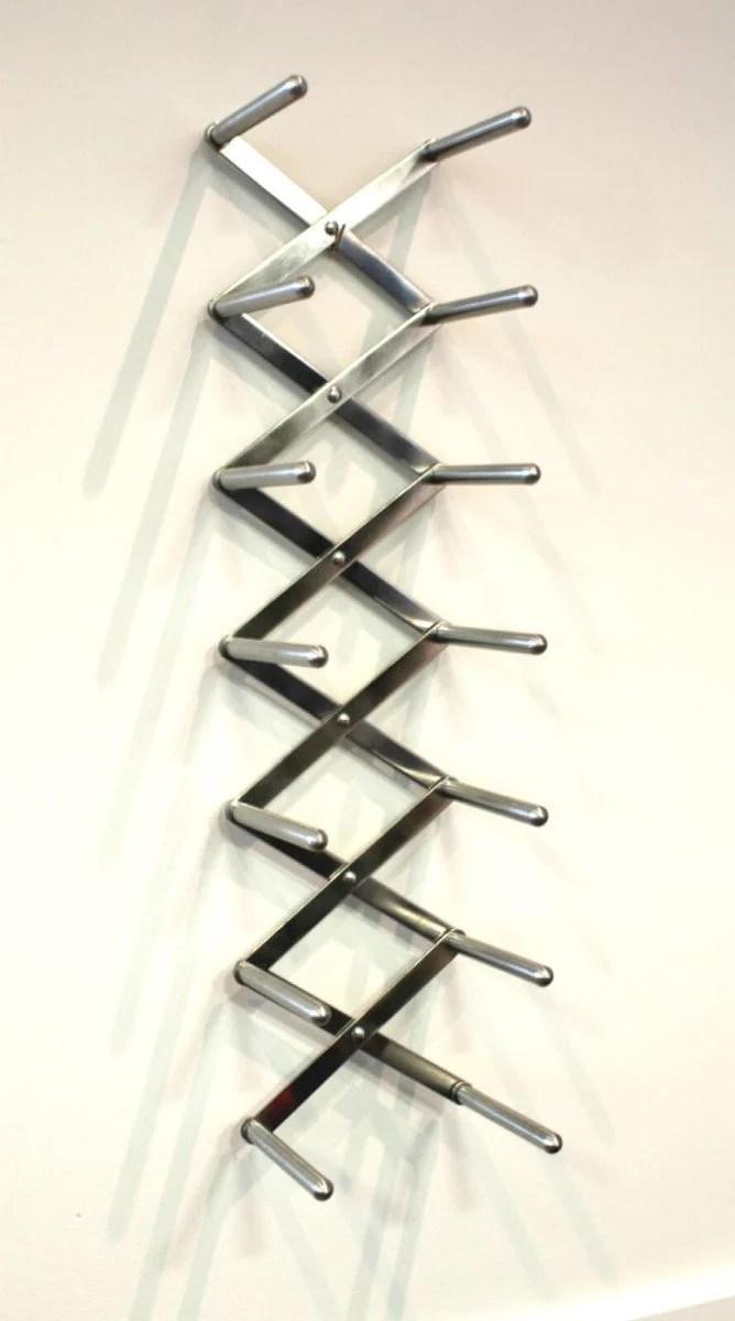slick modern wall mounted shoe rack ikea hackers. Black Bedroom Furniture Sets. Home Design Ideas