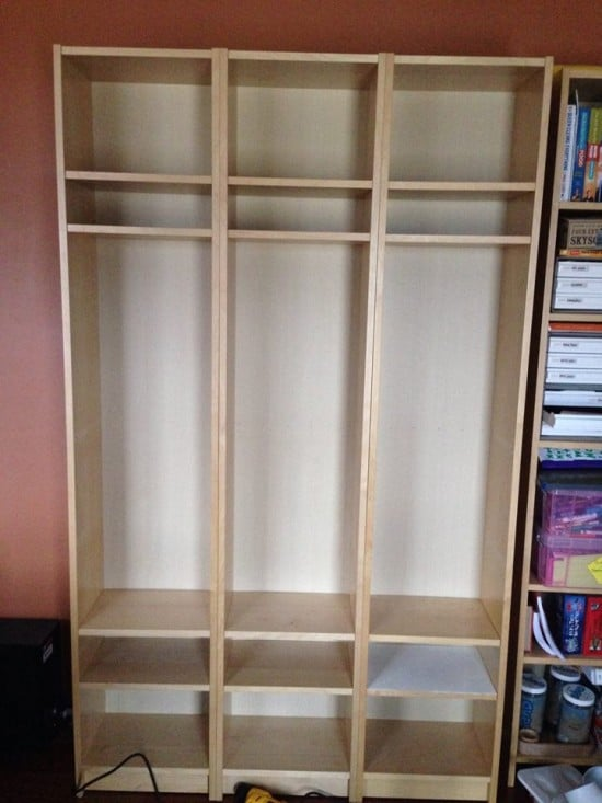 We removed the center support shelf and screwed the shelves together through the pinholes.