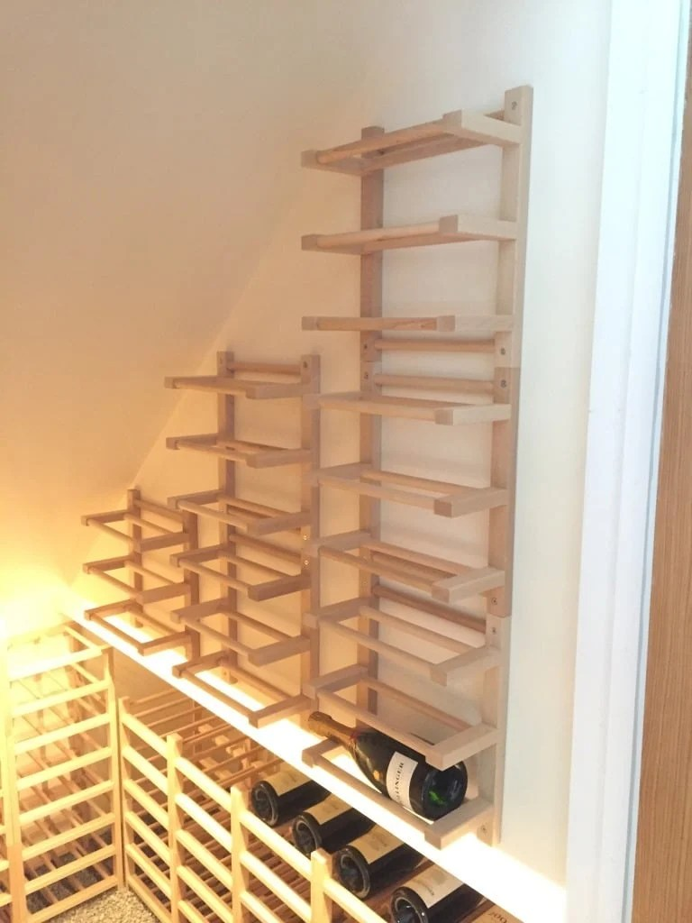 Wall wine rack a brogrund towel rail hack ikea hackers for Wine shelves ikea