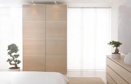 PAX wardrobe with wood grain sliding door panels