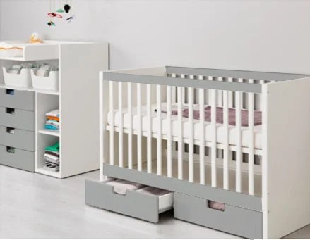 Lovely STUVA cot with HIMMELSK bumper pad as crib skirt