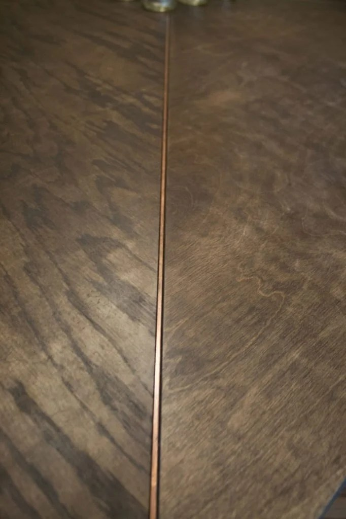 Copper details in Square Dining Table