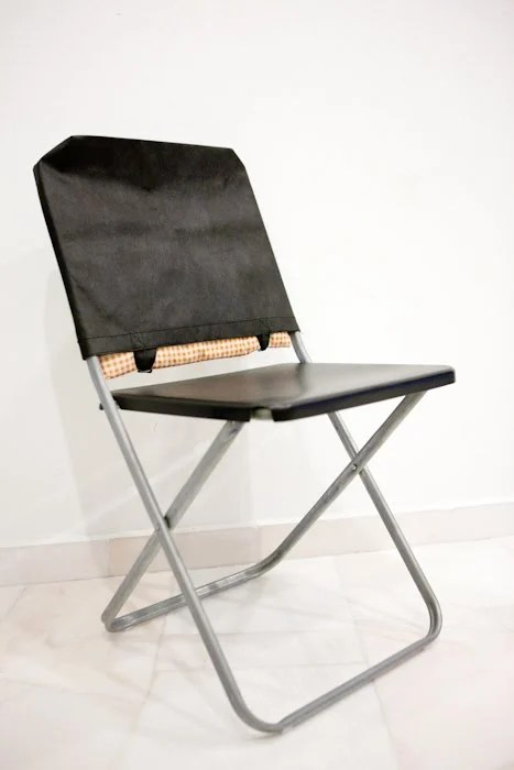 Materials: Ikea JEFF Folding Chair, Non Woven Recycle Bag, 1 Foot Square  Pillow (Optional), Duck Tape, Steel Wire