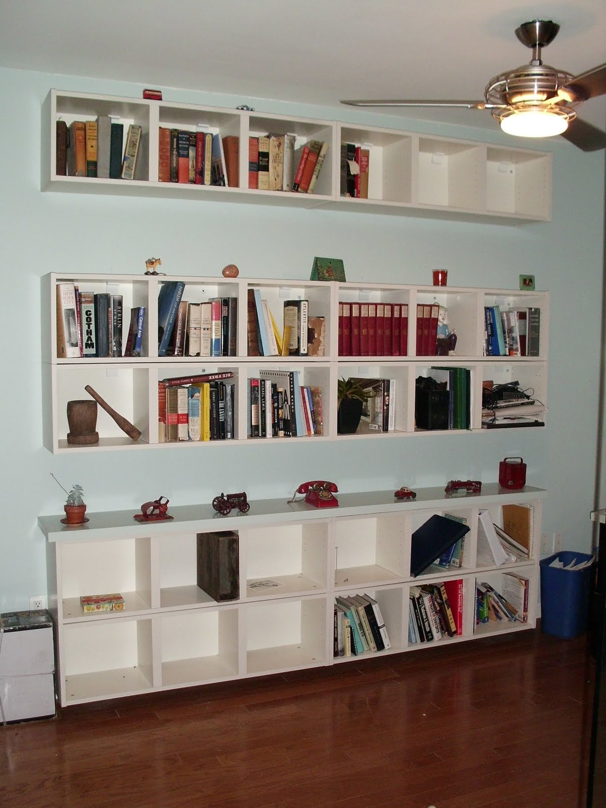 Note that the side walls of Billy Wall shelves extend a little above the  top horizontal and bottom horizontal which creates a space between the  units.