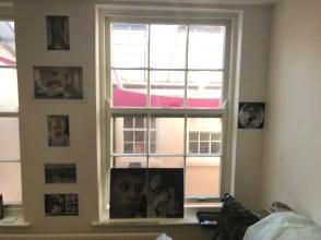 iPhone snapshot of prints on my studio wall