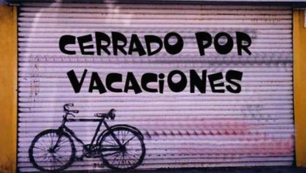 Cerrado por vacaciones; el origen de las vacaciones (pagadas o no)