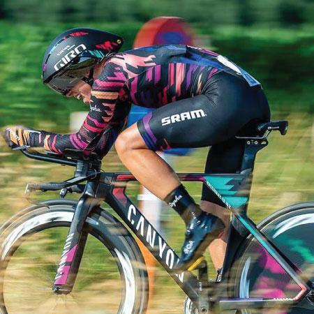 Leah Thorvilson riding a tri bike in aero bar position