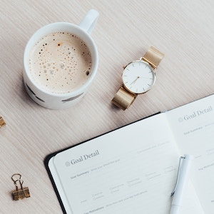thumbnail sized image of coffee mug, gold watch, and daily planner