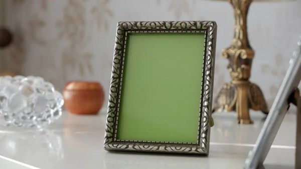 Single Picture Frame With Green Screen On Side Table. With ...