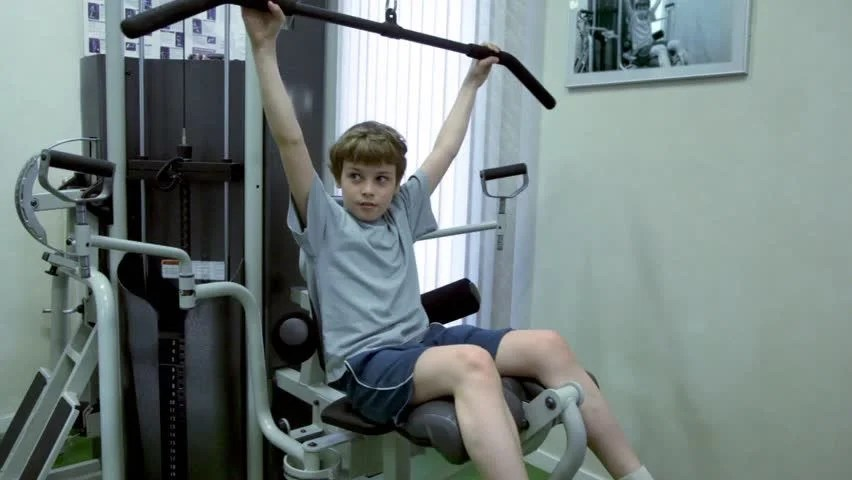 Two Kids Train In Gym Boy Haul Training Equipment And