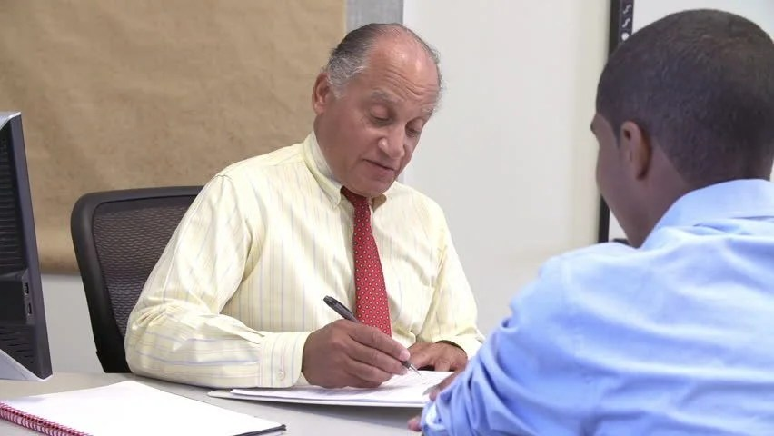 Male Student Talking To High School Counselor Stock Footage Video 7344211 - Shutterstock