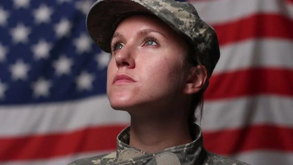 Female Soldier In Front Of US Flag, Looking Up Stock ...